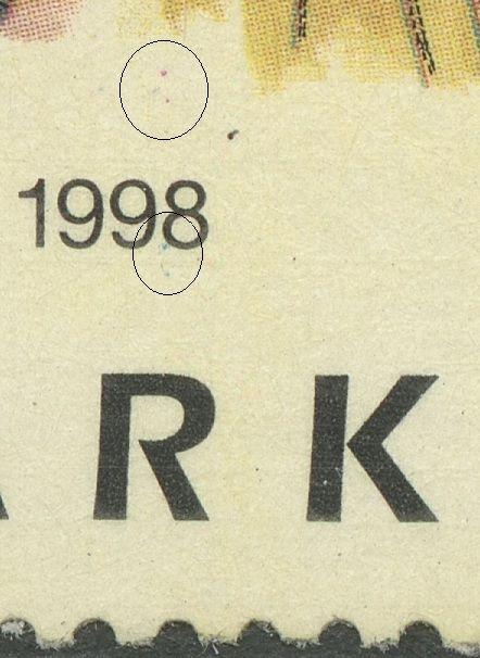 Magenta plet over 1998 og cyan plet under