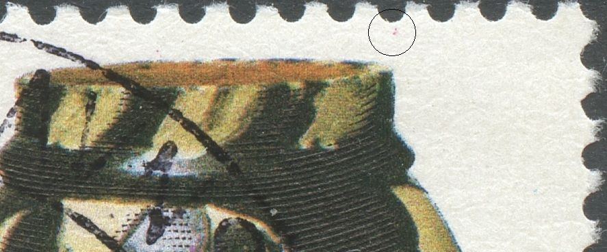 Magenta plet over vasens h. kant