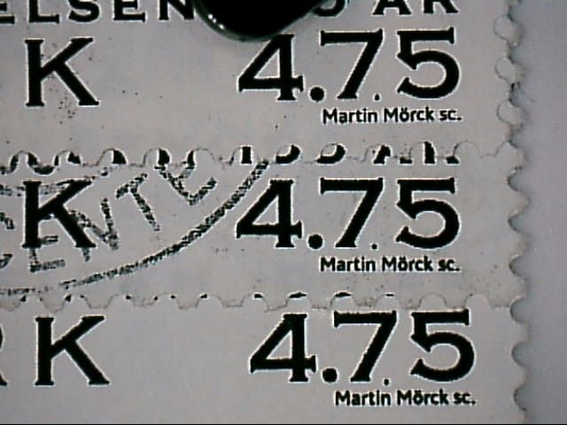 Sort plet mellem 7og 5 over n i Martin.